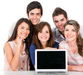 Group of with a laptop — Stock Photo