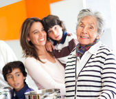 Grandmother cooking for the family — Stock Photo