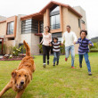 Family running after the dog — Stock Photo #11130640