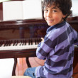 Boy piano — Stock Photo #11130646