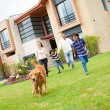 Family running with a dog — Stock Photo #11130648
