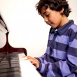Boy playing piano - Stock Photo