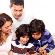 Family reading a book — Stock Photo #11130667