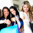 Shopping women pointing at the camera — Stock Photo