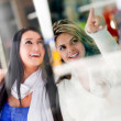 Friends window shopping — Stock Photo