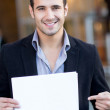 Businessman with a poster — Stock Photo