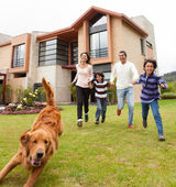 Family running after the dog — Stock Photo