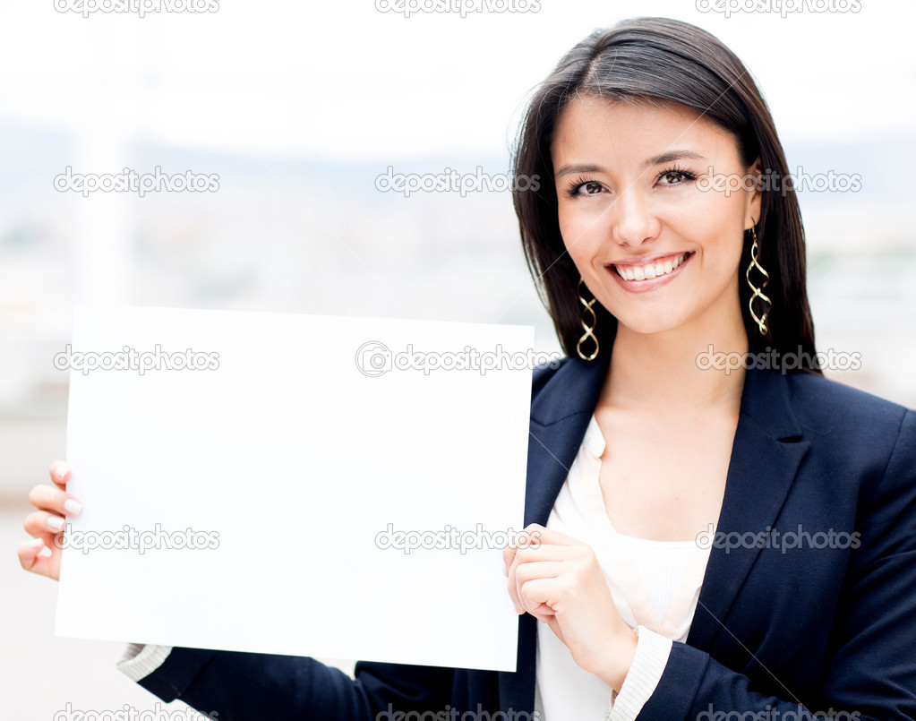 Businesswoman holding a white poster and smiling — Stock Photo #11130665