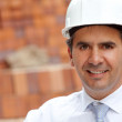 Male engineer at a construction site - Stock Photo