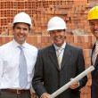 Architects at construction site — Stock Photo #11163775
