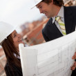 Architects at construction site — Stock Photo #11163799