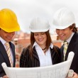 Architects at construction site — Stock Photo #11163814