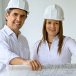 Architects at construction site — Stock Photo #11163924