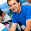 Man spinning at the gym - Stock Photo