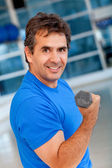 Gym man with free-weights — Stock Photo