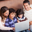 Stock Photo: Family with a laptop