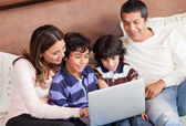 Family with a laptop — Stock Photo