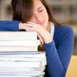 Student sleeping in the library — Stock Photo