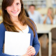 Female student at the library — Stock Photo #11271091