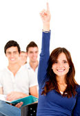 Student in class raising hand — Stock Photo