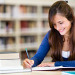 Girl at the library — Stock Photo