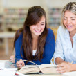 Students at the library — Stock Photo #11293682
