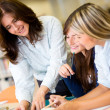 Female students at library — Stock Photo #11293751