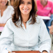 Stock Photo: Teacher in a classroom