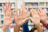 Students raising their hand — Stock Photo