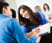 Students talking in class — Foto Stock