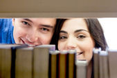 Students hiding at the library — Stock Photo