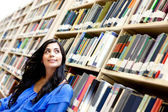 Pensive woman at the library — Stock Photo