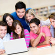 Students with a laptop computer — Stock Photo #11375749