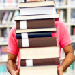 Stock Photo: Mcarrying heavy books