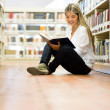 Female student at the library — Stock Photo