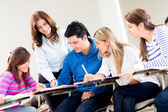 Teacher helping some students — Stock Photo