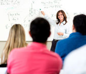 Teacher giving a lecture — Stock Photo