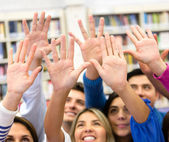 Students raising their hands — Stock Photo