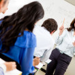 Woman teaching a class — Stock Photo