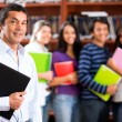 Teacher with a group of students - Stock Photo