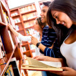 Students at the library - Stock Photo
