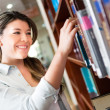 Female student at the library - Stock Photo