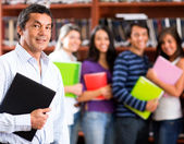 Teacher with a group of students — Stock Photo