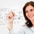 Teacher wiriting formulas - Stockfoto