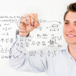Student writing formulas — Stock Photo