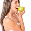 Foto Stock: Woman biting an apple