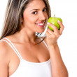 Woman eating a fruit — Stock Photo