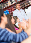 Man giving a lecture — Stock Photo