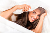 Woman under the sheets — Stock Photo
