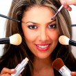 Stock Photo: Woman putting makeup on